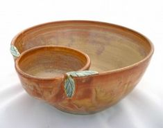 Extra large handmade pottery chi-n-dip bowl in a burnt orange glaze with green leaves detail; also great for chips and salsa, nuts and shells, wings and celery, etc.