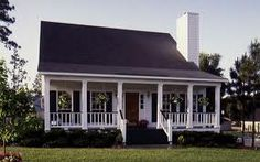 picture of house with porch across front and white railing   small ...