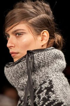 To show off the luxe knits of Rag and Bone's fall line, Guido used Redken Guts 10 volumizing foam, followed by Powder Refresh to add a hint of grit to the hair before pulling it back into an alterna-chignon.