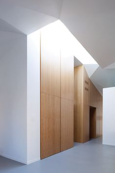Good wood detailing and tone Rome apartment modernised with faceted ceilings and minimalist staircase