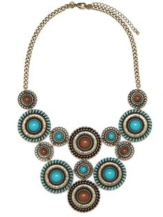 Work the prairie vibe with a statement necklace constructed from intricately detailed circles.  The muted color palette and homespun detailing give it a toned down vibe.