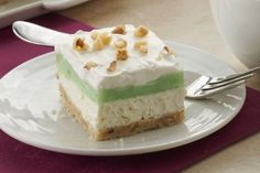 For a treat that's a little nutty, in the good sense, this Pistachio Layered Dessert with pistachio Jell-O pudding and fresh walnuts hits the spot. It's delicious and one of my fav desserts! Pistachio Dessert, Dessert Mousse, Pistachio Pudding, Pistachio Cheesecake, Pudding Desserts, Köstliche Desserts, Dessert Recipes, Cream Cheeses, Cream Cheese Spreads