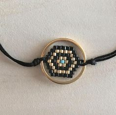 Peyote handmade evil eye bracelet, geometric shaped polygon embroidered in hand (no loom) with Miyuki Delica Beads in many colors. The jewel framed by satin cord, gold plated brass small circle or without but with crystal faceted bead and two gold plated brass cubes. Its closure is made