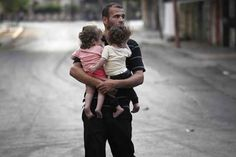 """Others walked miles, arriving in Gaza City holding only their children in their arms. """"There are people outside begging for food and shelter,"""" said Amin. """"We don't know where to put them or how to begin to cope."""" 