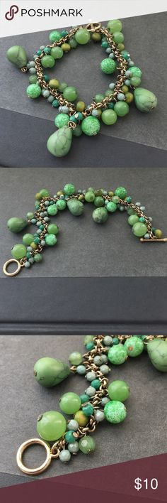 Beautiful green and gold bracelet. Dangly stones Lovely and Classic. Green dangle stone beaded bracelet. Beads hang from a gold colored chain. Mom-adjustable. Older piece so does have signs of wear and aging. Jewelry Bracelets