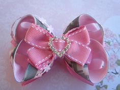 Military hair bow - Digitalized ACU print - Pink Flowers with Rhinestones - Hair Clip for Ladies, Girls and Toddlers. $8.50, via Etsy.