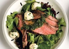 Flank Steak Salad with Chimichurri Dressing  The famous Argentine herb sauce is thinned out with a little more olive oil and vinegar to make a bright herbal dressing for the salad. Instead of a big rib eye, this recipe calls for flank steak, a thin cut that's ideal when you're pressed for time.