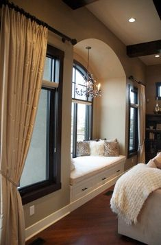 Window seat WITH a chandelier!? perfect . This would be an epic touch to a bedroom. LOVE THIS T