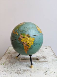 This is a gorgeous vintage French globe on three metal feet — super stylish! It's richly colored, with amazingly saturated colors — perfect for photos! French Industrial Decor, Antique Clocks, Saturated Color, French Vintage, Wordpress Theme, Home Goods, Globe, Mid Century, Antiques