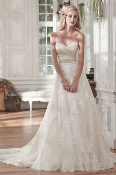 Style Kamiya Timeless and elegant, this romantic lace and tulle A-line wedding dress features a stunning L'Amour satin pleated bodice and lightweight lace and tulle skirt, accented with a delicate Swarovski crystal embellishment at the waist....