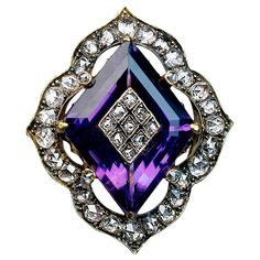 For Sale on - circa 1890 The ring features a step-cut diamond shape amethyst inlaid with a diamond encrusted panel. The amethyst is set in an ornate bezel embellished Antique Diamond Rings, Gold Diamond Rings, Purple Diamond, Purple Amethyst, Purple Yellow, Or Antique, Antique Jewelry, Vintage Jewelry, Amethyst Jewelry