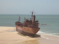 """""""UNITED MALIKA"""", a 387.8 foot reefer vessel with a cargo of fish, ran aground in a remote location called """"Cap Blanc"""" near the shore of Nouadhibou, Mauritania, on August 4th, 2003. The 17-member crew was rescued by the Mauritanian Navy."""