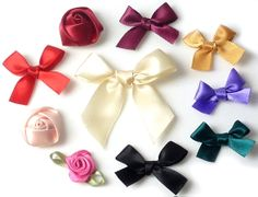#Bows in different colors.   Take a look!  http://www.snowfall-beads.com/beads/textile/bow-ties/sig/3327