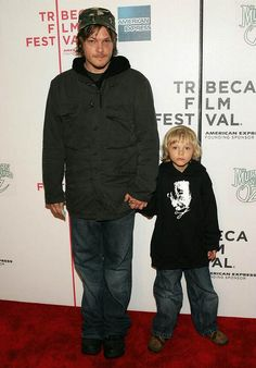 Love him! - Norman Reedus  [I wonder if Norman misses those days of holding his little boy's hand? Now Mingus is taller than him. lol]