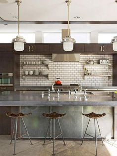 Kitchen design, dark wood cabinetry, white tiles, concrete bench