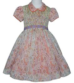 This is a beautiful smocked dress overlay with printed paisley sheer fabric, absolutely beautiful. The orange fabric underneath highlights its colors.