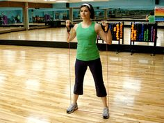 "This is a great way to take your ""air squats"" (body-weight squats) to the next level without a bunch of expensive equipment. Grab a resistance band for this total lower-body toner. 