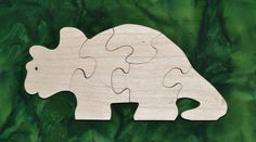 """This Triceratops Puzzle is fun to do and assists in the development of small motor, hand-eye coordination, visualization and problem solving skills all of which are important in the process of reading. Our puzzles are made from toy quality 1/2"""" Baltic birch plywood and are rubbed with AMF Naturals, an oil wax finish that is completely safe. Dimensions: 3.75"""" high, 8.25"""" long"""