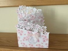 Tri fold card with tonic flower over the edge die