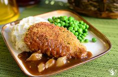 Williamsburg Pork Chops With Mashed Potatoes - These lean, juicy, boneless pork chops are breaded and seasoned with the flavors of paprika, rosemary, thyme and garlic. Seared to a golden brown, paired with our creamy mashed potatoes and topped with a pearl onion gravy, making the perfect end to a busy day.