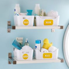 Holding Zone  Use a pair of floating shelves to transform wasted vertical space -- such as next to a vanity or bathroom mirror -- into useful storage. Fill the shelves with small caddies designated for each family member to corral toothpaste, soaps, washcloths, and other bathroom necessities. Decorative labels adhered to the front of each bin provide easy identification for the whole family.