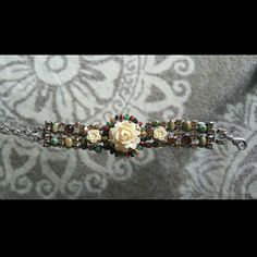 Rose Faux Ivory Primavera Bracelet by Mary Demarco Stunning bracelet made of pewter, semi-precious stones and Swarovski crystals. Rare peice. In great condition with no missing stones. Mary Demarco Jewelry Bracelets