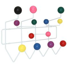 Gumball modern Coat Rack in MultiColored (EEI-216-MULTI). With its array of assorted confectioneries, hang it all from the bright yellow raincoat.