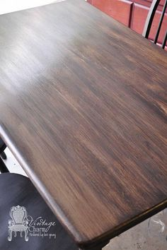 painting on chalk paint with stain to give wood look
