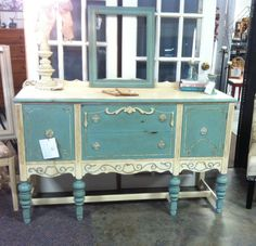 I painted this pretty buffet with ASCP Duck Egg & Old White!