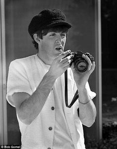 Paul McCartney. A picture of a Beatle taking a picture.