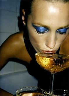 just a typical night out for me and the ladies.  by Helmut Newton