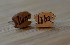 Have you ever wanted to bring a piece of Stars Hollow home with you? This adorable pair of stud wood earrings is just the ticket! Paying homage to the delicious coffee sold at Luke's, you'll feel like
