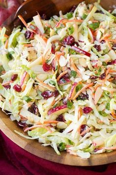 INGREDIENTS : 10 oz package shredded cabbage 4 scallions, sliced 1 tablespoon sesame oil ¼ cup reduced sodium soy sauce 1 tbsp rice vinegar 1 tbsp sugar ⅓ cup dried cranberries sprinkle o