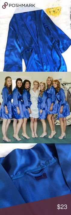 Cobalt blue satin robe Gorgeous cobalt/royal blue satin robe! Thin material but very soft and has a beautiful color.  I wore it as a bridesmaid - pictured on me, on the far right of the group photo. There's no tag, just a small mark where a label w/my name was heat pressed onto the fabric & torn off (pictured). It doesn't have a size on it - it appears to be one size, but I'm typically a size small. See photo for reference. Intimates & Sleepwear Robes