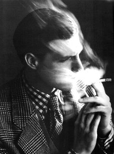 A tweed suit and a lot of smoking coming out of his mouth (and head?).