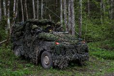 Estonian soldiers from the 1st Scouts Battalion moving through the woods during Exercise Siil / Steadfast Javelin in Estonia. May 11, 2015.