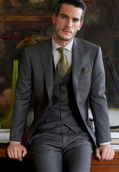 Dapper combination of stone gray 3-piece suit, tie, and pocket square