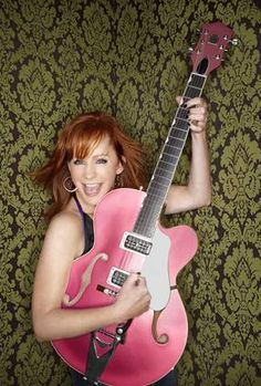 """She likes to play. She loves to rock. Yeah, she's closer to the bottom, but she's headed for the top. She's got a dream to be a star dressed in black like Johnny Cash, with a pink guitar""-Reba"