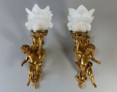 Antique French Pair of Bronze Cherubs Wall Sconces by LaLoupiote