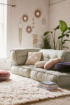 Gorgeous boho style lounge room - I love the floor cushion, the wall hangings and the large rug on the floor.
