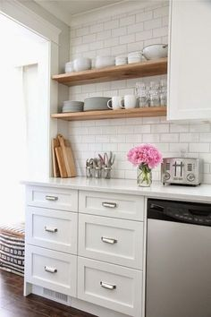 source: Our House White kitchen with white shaker cabinets painted Benjamin Moore Cloud White accented with Restoration Hardware Duluth Pulls paired with white quartz countertops and Home Depot subway tile backsplash. Kitchen features stacked floating s Small Kitchen, Kitchen Remodel, Kitchen Decor, Kitchen Remodel Small, New Kitchen, Kitchen Dining Room, Home Kitchens, Kitchen Renovation, Kitchen Design