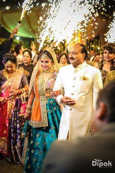 Bridal Lehengas - Velvet Royal Blue Lehenga with Pink Velvet Blouse and Orange Net Dupatta   WedMeGood   Bridal Entry with Father of the Bride #wedmegood #indianbride #bridalentry #velvet #lehenga #bridal #choli #indianwedding