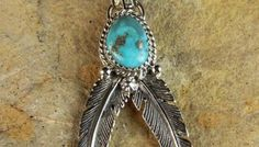 Natural Turquoise Feather Navajo Sterling Silver Pendant by Thomas Yazzie
