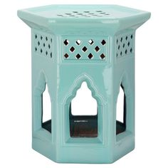 Add lovely appeal to your home library or living room with this openwork ceramic garden stool, showcasing a pagoda-inspired design and light blue finish.