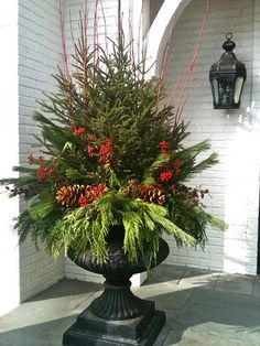 XMAS: Love this Christmas Urn . even a little Christmas tree in the middle! Christmas Urns, Christmas Planters, Outdoor Christmas Decorations, All Things Christmas, Winter Christmas, Christmas Holidays, Christmas Crafts, Merry Christmas, Christmas Greenery