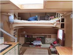 awesome 20 ft long teardrop-style travel trailer with loft bed, propane heat, shower, full kitchen, and lounge area.