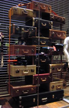 Old, vintage suitcases used as shelving in a shop display, inspired Repinned by www.silver-and-grey.com