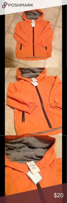 NWT baby Gap windbreaker. New with tags baby Gap windbreaker in orange. Water resistant and lined with grey cotton/polyester blend. Hood. Shell is 100% nylon with a water resistant coating. Sleeves are lined with polyester. Size 2 years. GAP Jackets & Coats