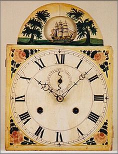 The arched dial is colorfully painted on wood. It is an usual dial in that it features an automated rocking ship in the arch section. This ship moves with the motion of the pendulum. It moves in a side to side pattern as if it is sailing in the waves on the open sea. The spandrel areas of this dial are decorated with colorful florals. The time ring features Roman numerals and a seconds dial. This dial is not signed.