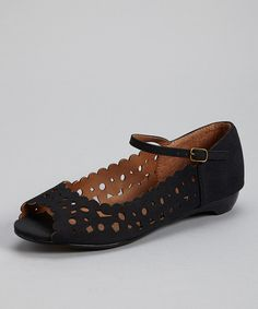 Have high fashion on hand with these flats. Their buckle closure finds the right fit, and the peep-toe silhouette and cutout design add a posh finish.